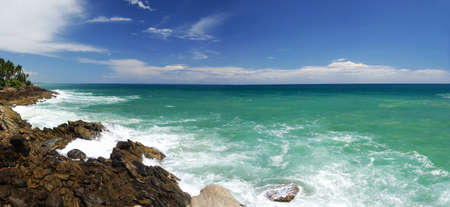 Mighty waves are striking the rocky coast of Souhern Sri Lanka. Panorama photo
