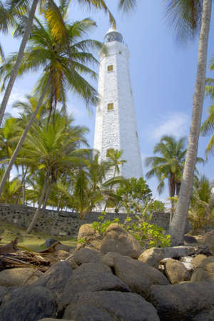 Beautiful white lighthouse Dondra Head, the southest cape of Sri Lanka. The lighthouse is also a highest (161 feet) not only on the island but also in the whole Asia photo