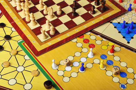 Various board games of ludo, halma, chess and fox and geese  photo