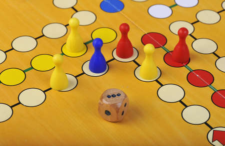 The ancient board game of Ludo (Take it Easy) is trully international. It has its original and specific name and version in many countries across the Globe. Stock Photo - 12868884