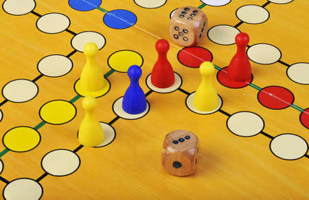 horseplay: The ancient board game of Ludo (Take it Easy) is trully international. It has its original and specific name and version in many countries across the Globe. Stock Photo