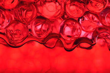Background made of red gel water pearls photo
