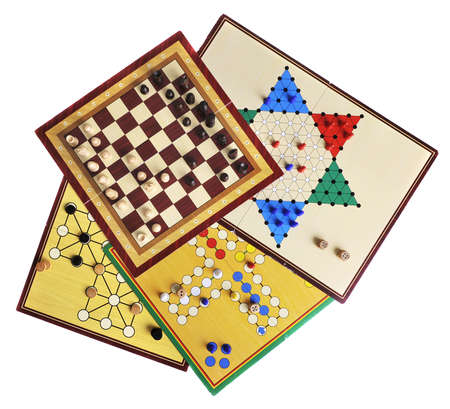 ludo: Various board games of ludo, halma, chess and fox and geese isolated on white Stock Photo