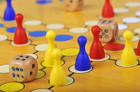 The ancient board game of Ludo (Take it Easy) is trully international. It has its original and specific name and version in many countries across the Globe. Stock Photo - 12868873