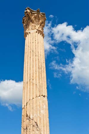 Nice ancient roman pillar against a blue sky photo