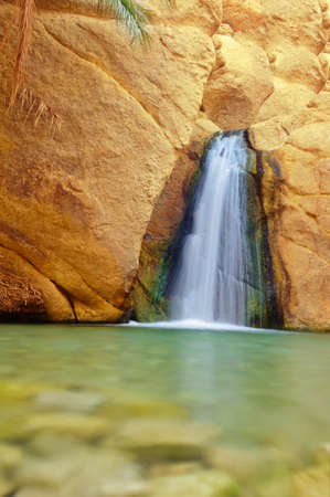 Small but beautiful waterfall from the limestone near the mountain oasis Chebika, Tunisia