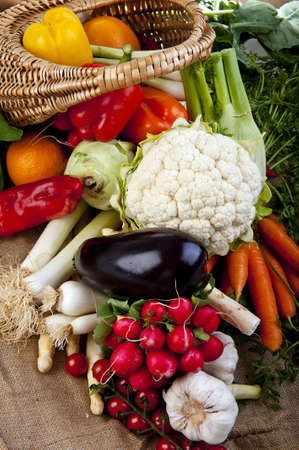 Basket full of various fresh organic vegetables from the garden photo