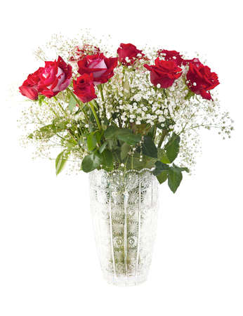 Beautiful red roses bouquet in a crystal vase isolated on white photo