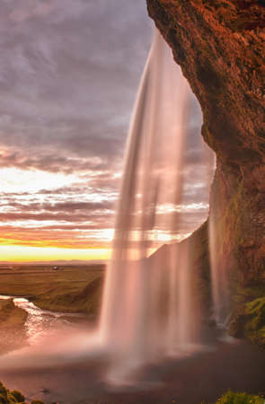 Seljalandsfoss is one of the most beautiful waterfalls on the Iceland. It is located on the South of the island Stock Photo