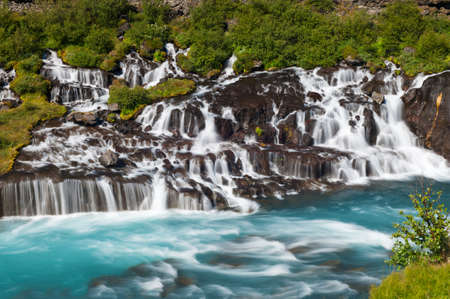 Hraunfossar is a very beautiful Icelandic waterfall in the west of the island photo