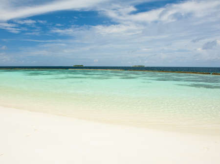 Beautiful crystal clear Maldivian sea with a beach photo