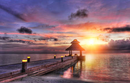 Awsome vivid sunset over the jetty in the Indian ocean, Maldives. HDR  photo
