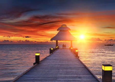 Awsome vivid sunset over the jetty in the Indian ocean, Maldives. HDR  Imagens