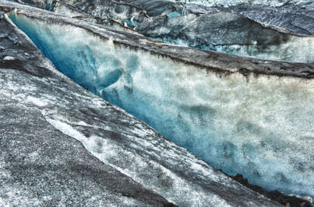 Detailed of the Icelandic dirty glacier ice with a incredibly vivid colors and a nice texture photo