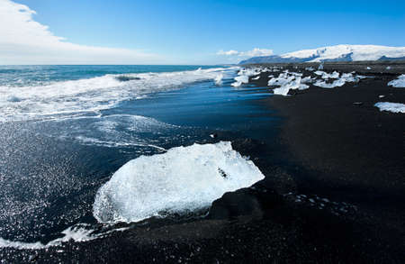 not full: Beautiful beach in the South of Iceland with a black lava sand is full of icebergs from glaciers not far away Stock Photo