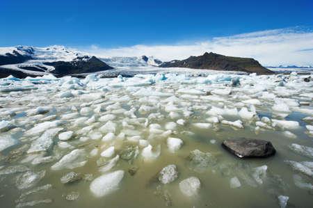fjallsarlon: Beautiful of Fjallsarlon Glacial lake full of floating icebergs near the Fjallsjokull glacier Stock Photo