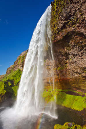 Seljalandsfoss is one of the most beautiful waterfalls on the Iceland. It is located on the South of the island. With a rainbow. photo
