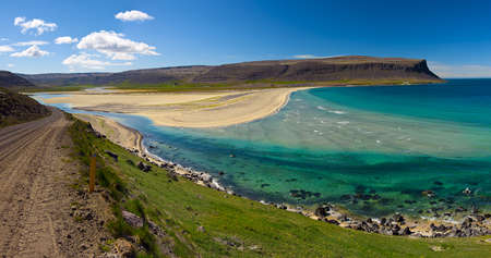 Extremly beautiful bay with mighty golden beaches and turquise sea in the West Fjords, Iceland. Panoramic  photo
