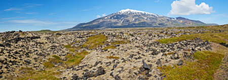stratovolcano: Volcano Snaefell on the western end of Icelandic peninsula Snaefellsnes is covered by a glacier Snaefellsjokull, panoramic  Stock Photo