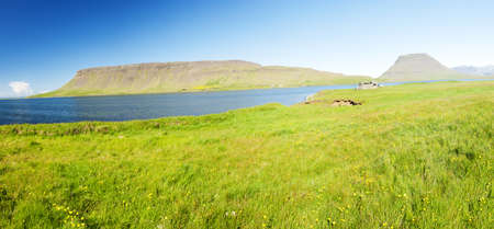 Mighty fjords rise from the sea in the Westfjords Peninsula, northwestern Iceland