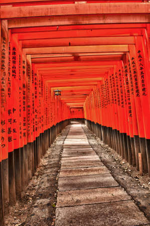 Famous shinto shrine of Fushimi Inari Taisha near Kyoto includes around 1300 orange torii gates, Japan Editorial