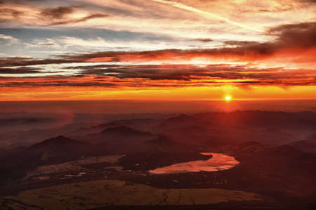 dramatic sunrise: Beautiful vivid sunrise seen from the mount Fuji at the lake Kawaguchi, Japan