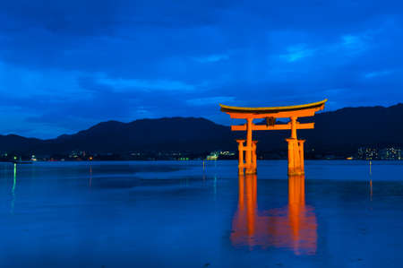 Great floating gate (O-Torii) on Miyajima island near Itsukushima shinto shrine, Japan shortly after the sunset