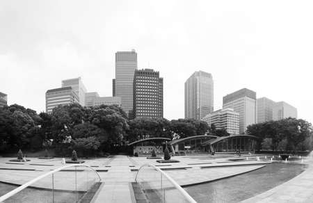 Futuristic photo of Tokyo - panoramic shot of skyline in Shinjuku in black and white, Japan Stock Photo