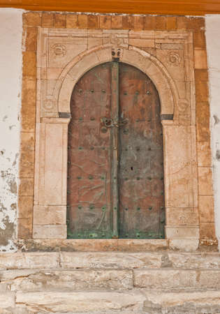 arabic architecture: Beautiful ornamental door of so typical shape for Tunisia