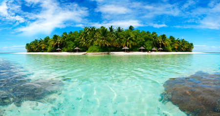 Beautiful Maldivian atoll with white beach seen from the sea.Panorama photo