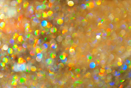 Beautiful vivid defocused christmas background. Major color is gold the other add the Christmas twinkle atmosphere photo