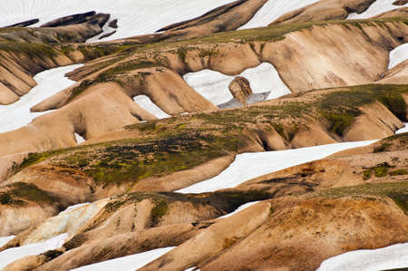 Beautiful multicolored mountains and snow avalanches at Landmannalaugar, Iceland photo