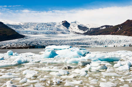 fjallsarlon: Beautiful photo of Fjallsarlon Glacial lake full of floating icebergs near the Fjallsjokull glacier Stock Photo