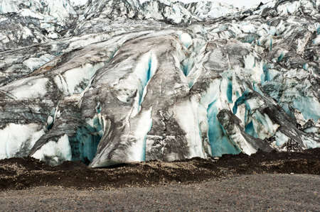 Detailed photo of the Icelandic glacier ice with a incredibly vivid colors and a nice texture photo