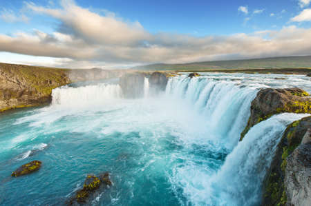 waterfall with sky: Godafoss is a very beautiful Icelandic waterfall. It is located on the North of the island not far from the lake Myvatn and the Ring Road.