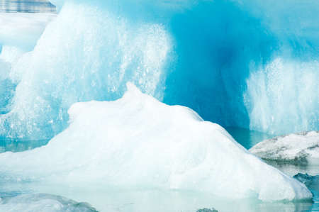fjallsarlon: Detailed photo of the Icelandic glacier iceberg in a ice lagoon with incredibly vivid colors and a nice texture
