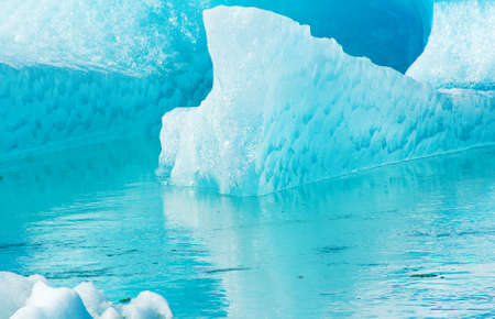 Detailed photo of the Icelandic glacier iceberg in a ice lagoon with incredibly vivid colors and a nice texture Stock Photo - 17924015