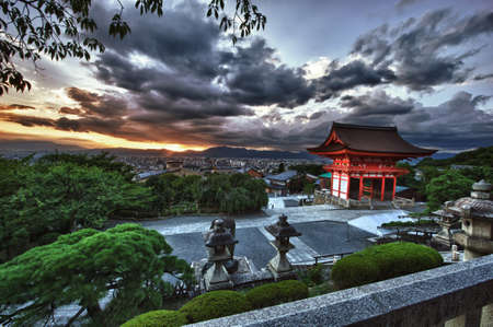 Beautiful dramatic sunset seen from the Kiyomizu-dera shrine above Kyoto, Japan. HDR