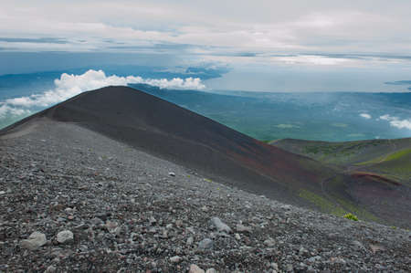stratovolcano: Photo taken during the descent from the Mt. Fuji. Slopes of the mountain are multicolored - which is caused by various igneous minerals and palnts. Japan