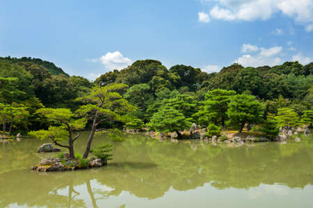 meditaion: Zen Garden with pines and a pond in Kyoto, Japan Stock Photo
