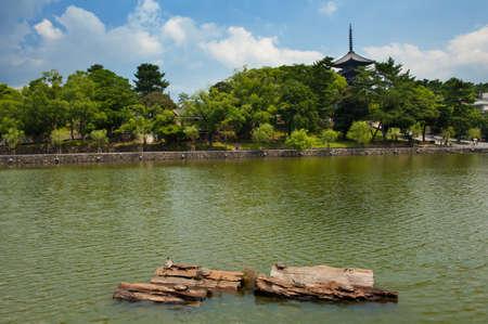 storied: View at Five-storied pagoda of the Kofuku-ji temple at Nara, Japan and a park with turtles