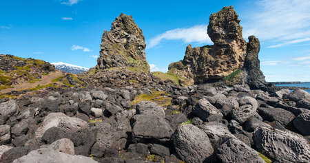 Two major basalt formations at Londrangar. Snaefellsness peninsula, Icelnad photo