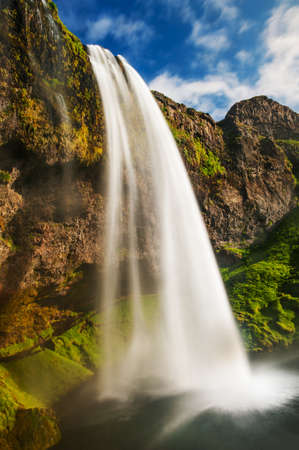 Seljalandsfoss is one of the most beautiful waterfalls on the Iceland. It is located on the South of the island. Stock Photo - 20456863