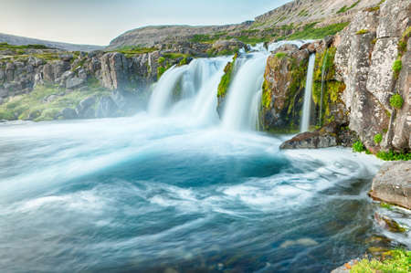 waterfall with sky: Dynjandi is the most famous waterfall of the West Fjords and one of the most beautiful waterfalls in the whole Iceland. It is actually the cascade of waterfalls