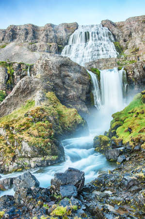 Dynjandi is the most famous waterfall of the West Fjords and one of the most beautiful waterfalls in the whole Iceland. It is actually the cascade of waterfalls of which the one on the photo is the largest one. Stock Photo - 20456920