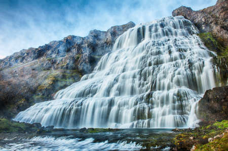 waterfall with sky: Dynjandi is the most famous waterfall of the West Fjords and one of the most beautiful waterfalls in the whole Iceland. It is actually the cascade of waterfalls of which the one on the photo is the largest one.