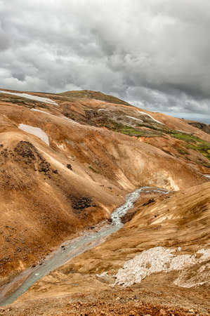 crater highlands: Iceland is a land of ice and fire. In the geothermal area Kerlingarfjoll one can see smoke and boiling fumaroles from the geothermal field as well as mountains covered by ice and snow. Stock Photo