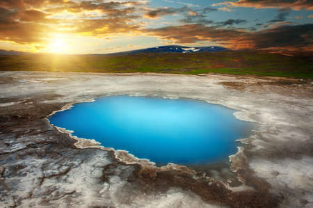 Incredibly blue pool Blahver at Hveravellir is actually a hot geothermal spring in the heart of Iceland. Photo taken around midnight sunset Stock Photo
