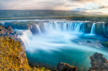iceland: Godafoss is a very beautiful Icelandic waterfall. It is located on the North of the island not far from the lake Myvatn and the Ring Road. This photo is taken after the midnight sunset with a long exposure