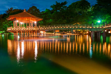 japanese maple: Nice japanese wooden gazebo is shortly after the sunset reflecting in the water. Nara, Japan.